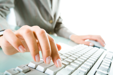 female-worker-typing-at-keyboard-fingers